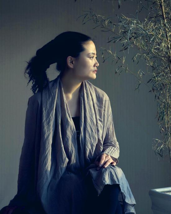 2004年,毕业于中央音乐学院,是古琴演奏专业的第一位硕士.图片